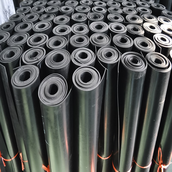 Warehouse,Rolls,Of,Rubber.,Black,Coating,Rolls.